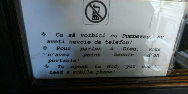 A funny sign on the door of a church. Gotta love Romanian humor…